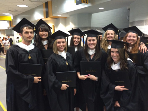 MFT program graduates in cap and gowns at graduation ceremony