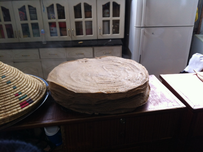 One of the mothers at the Muday Home for Children in Addis Ababa makes the famed Ethiopian injera bread.