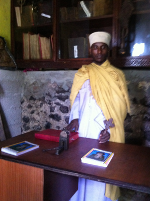 Monk shows us a Holy Book written in ancient, Ethiopia dialect back in the 7th century.