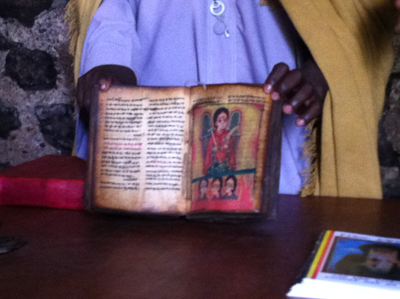 A Monk shows us a Holy Book written in ancient, Ethiopia dialect back in the 7th century.